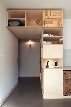 Living in a shoebox | Hotel room with a lot of clever storage solutions and salvaged materials