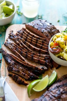 Grilled Asian Flank Steaks with Pineapple Salsa will become one of your new Summer grilling go-to's! The steaks are marinated to have an Asian flare and then grilled to perfection, and then topped of with a sweet, spicy, zesty pineapple salsa to make your tastebuds sing! Simple ingredients paired together perfectly to create a delicious meal. Get the recipe on http://kjandcompany.co - KJ & Company #recipe #grilling #summer #steak #healthyrecipes #salsa #dinner