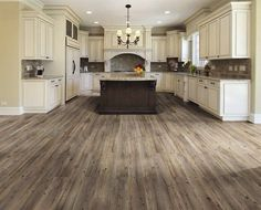 Love the wood flooring and the contrast of the white cabinets and dark wood in the center.