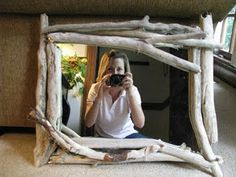 DIY driftwood accented mirror. I saw this in a magazine once, done on a much larger mirror. The driftwood is such a lovely touch.
