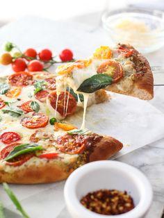 Pesto Pizza with Fresh Tomatoes and Mozzarella | foodiecrush.com