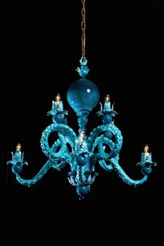 Cephalopod aficionados looking to spice up their lighting should look to Adam Wallacavage's Octopus Chandeliers. His unusual light fixtures hold up their bulbs with sucker-bearing tentacles that come in a variety of colors and levels of kitsch. Octopus Lamp, Octopus Decor, Blue Chandelier, Nautical Chandelier, Flower Chandelier, Crystal Chandeliers, Home Decor Near Me, Diy Holz, Will Turner