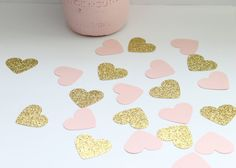This super cute confetti comes in a set of 100 (50) gold glitter and (50) blush pink hearts. Each piece measures approximately 1.5 inches