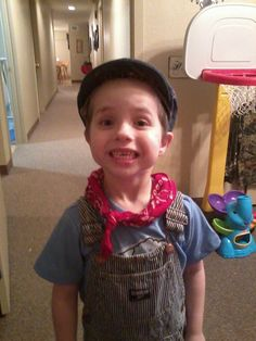 Halloween does not need to be expensive, taking what you already have at home can make for a great halloween costume for your kids and grandkids. Train Conductor using a bandana, overalls, ball cap, and a huge smile.  Find an old lantern and you are set!