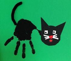 Katze mit Handabdruck - Kinderspiele-Welt.de