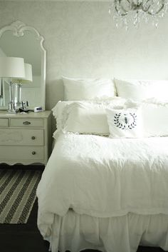 Beautiful romantic bedroom design with white damask walls, white vintage dresser, white mirror, glass column lamp, white bedding and crystal chandelier. White Rooms, White Bedroom, Master Bedroom, Log Home Decorating, Decorating Ideas, Shabby Chic Bedrooms, White Bedding, White Linens, Dream Rooms