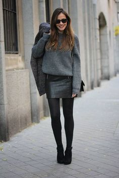 Cool in leather skirt and oversize sweater.