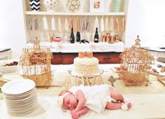 The cake behind the beautiful baby is mine, ruffle ivory buttercream and gold bow Ruffle cake