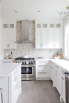Custom Cabinets & harringbone pattern tile backsplash in this kitchen designed b. Custom Cabinets & harringbone pattern tile backsplash in this kitchen designed by Jillian Harris New Kitchen Cabinets, Kitchen Cabinet Design, Modern Kitchen Design, Kitchen Island, Modern Kitchen White Cabinets, White Ikea Kitchen, Shaker Style Cabinets, White Shaker Cabinets, White Cupboards