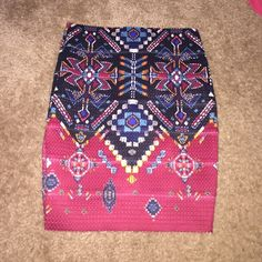 Aztec skirt size S Small tear in back - see pic 3. Zip back. Super stretchy. 12.5 inches across waist laying flat. 18 inches top to bottom. Xhilaration Skirts Mini