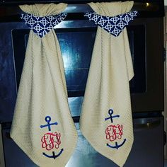 Nautical themed pull-through towels with anchor monogram from Cajun Clothiers
