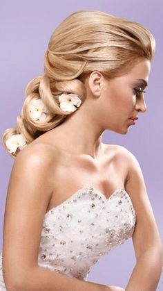 Beautiful Bride You could have crystal jewels instead of flowers with this #hairstyle. Either way you'd look stunning at your #wedding
