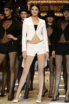 Doing her thing: Kendall Jenner flaunted her fantastic legs in tiny white shorts and a mat...