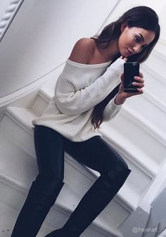 Im seeing a white sand beach, bare feet and some rolled up capris with this loose and cozy sweater. For something you can wear for all seasons, you need this cream one-shoulder sweater in your life. It's sweet, feminine and sultry all at the same time. (sp)
