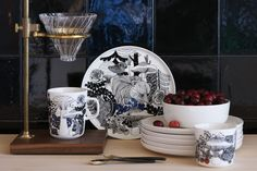 To celebrate 100 years of Finnish independence, Marimekko has launched a pattern called Veljekset (brothers) inspired by Finnish folk tales and the flora and fauna of its forests. The collection includes tableware, kitchen textiles, throws, and cushions. Marimekko, Flora Und Fauna, Vintage Kitchenware, Blue Plates, Nordic Design, Home Decor Items, Table And Chairs, Decoration, Finland