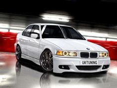 Bmw E36 with a body kit. Love the red white and black.