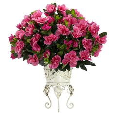 "Faux azalea arrangement in weathered metal vase.   Product: Faux floral arrangement   Construction Material: Silk and metal   Color: Pink  Features: Perfectly rounded full blooms Supported by a timeless vase    Dimensions: 19"" H x 20"" W x 18"" D"