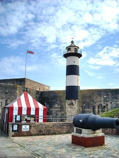 Southsea Castle and Lighthouse, Hampshire, England. Southsea Castle was built by Henry VIII in 1545 and it was from these walls that he watched his war ship The Mary Rose sink