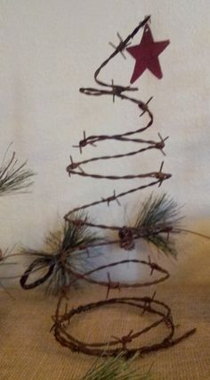 Great Center Piece idea: Rustic Barbed Wire Christmas Tree with Red Star Cowboy Christmas, Primitive Christmas, Country Christmas, Christmas Holidays, Christmas Ornaments, Western Christmas Tree, Western Christmas Decorations, Metal Christmas Tree, Christmas Swags