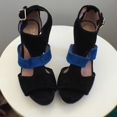 Vince Camuto black and blue studded platforms Woot here it is. These shoes will so rock your world or someone else's () they have never been worn and are waiting for a night out. 5 inch heel. Vince Camuto Shoes