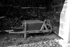 Woodshed and Old Wheelbarrow