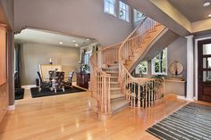 Wooden staircases ♥ > I like that when you walk in the front door you're not looking straight at the stairs