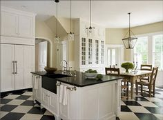 White kitchen cabinets with black granite countertops & black white tile floor. White Kitchen Floor, White Kitchen Cabinets, Kitchen Cabinet Design, Kitchen Black, Cream Cabinets, Big Kitchen, Kitchen Dining, Upper Cabinets, Kitchen Yellow