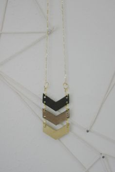 cutpath - brown, bronze, and gold laser cut leather chevron necklace. $25.00, via Etsy.