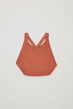 Made from a dense, double-sided fabric with a smooth, stretchy finish, this bikini top has a high-cut round neckline. Designed with a wide strap, crossover back, it is completed with zig-zag finishes.