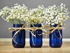 Set of Three Cobalt Blue Mason Jar Vases, Hand Painted Glass Tint This listing is for a set of three mason jars which are hand painted with a rich cobalt blue glass tint. They are perfect for vases, candle holders, and many other uses! You can use them for kitchen canisters, desk storage and organization, or tabletop decor. The glass tint is hand painted and then baked on to set. This makes the tint very sturdy, it is safe to put these in the dishwasher or hand wash. To preserve the finish…