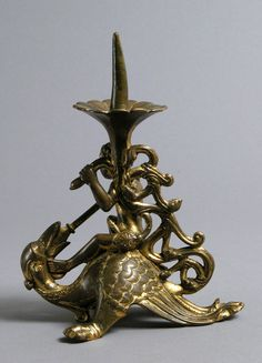 Pricket Candlestick with a Naked Youth Fighting a Dragon | South Netherlandish | The Metropolitan Museum of Art