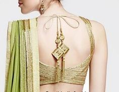 Loving the blouse design/cut!