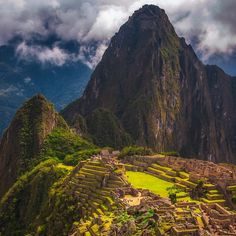 Taking it all in at Machu Picchu in Peru. Stunning view of this ancient Incan city | The Planet D: Adventure Travel Blog