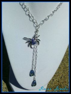 Check out this item in my Etsy shop https://www.etsy.com/listing/244052778/silver-spider-with-blue-rhinestones