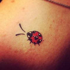 Cute tiny colorful ladybug tattoo - Tattoo.pm