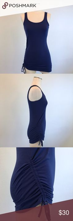 "prAna- Ariel Tank in Blue Twilight SZ S NWT prAna- Ariel Tank in Blue Twilight SZ S NWT. Soft, stretchy tank with a bra shelf for support. Scoop front and back. Ruching on the right side (adjustable). True to size. Armpit-armpit measures about 16"" across laid flat (and it stretches). Measures about 29"" in length from shoulder to hem. Tank: 45% recycled polyester, 45% polyester, 10% spandex. Lining of the tank (shelf): 92% Polyester, 8% spandex. Prana Tops Tank Tops"