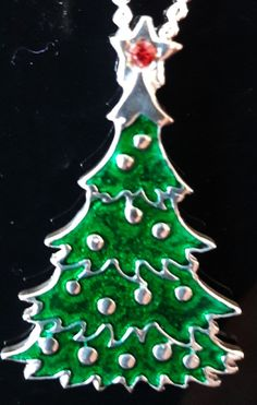 Solid pewter Christmas tree pendant with lovely detail including baubles, green enamel and star with a red crystal. Tree Pendant, Christmas Jewelry, Birthday Candles, Christmas Tree, Jewellery, Crystals, Green, Teal Christmas Tree, Jewels