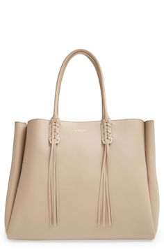 Love the pleated gussets and tassel detail on this sleek Lanvin tote.