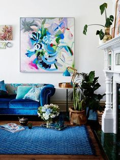 colorful living room, blue living room decor, artwork in living room