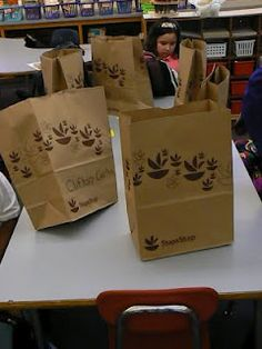 Paper bags with kids names on them, and supply list stapled on for keeping track of the supplies the kids bring in.