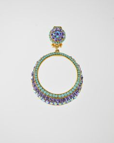Pave Hoop Drop Lilac & Turq. from Barrera. 24 karat gold plated drop hoop earring pavéd in Austrian crystals in a mix of lilac, iridescent aurora borealis and turquoise crystals. The earring is clip and is 2 inches long by 1.5 inches at widest point. #shopzindigo
