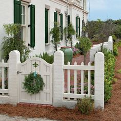 Hang a wreath or swag on entry gates to give a light and bright beach house a subtle hint of holiday green.