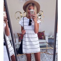 Love the dress and hat, perfect for the beach!