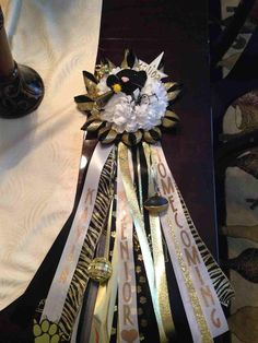 Mansfield PeeWee Football Association SENIOR Mum.  18 inch ribbons, cricut lettering with gold glitter vinyl. By Aimee Howell