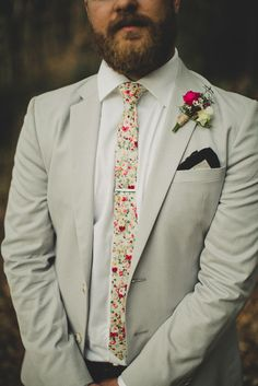 Skinny floral tie and polka dot pocket square - love this groom's eclectic look