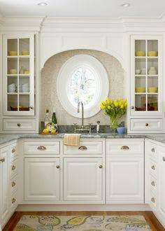 oval window above sink & cornice
