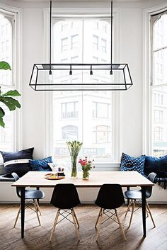 kitchen banquette with indigo dyed pillows and wood table with black bucket chairs / sfgirlbybay