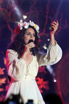 Description of . Lana Del Rey performs in concert at Bill Graham Civic Auditorium in San Francisco, Calif., on Friday, April 18, 2014. (Ray ...