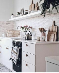 Beautiful white floating shelf to go along with the white cabinets and counters. We love the radness!