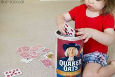Need a quick toddler activity to keep them busy? Try building this card slot drop activity! It's a winner that teaches tons of great motor skills.